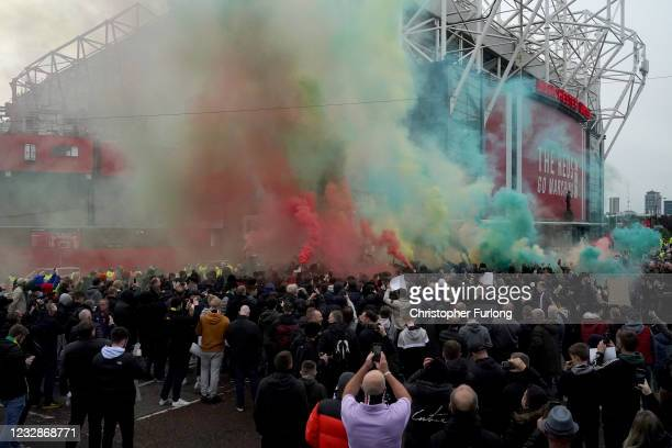 Protesters let off coloured smoke flares outside Old Trafford Stadium ahead of the Premier League match between Manchester United and Liverpool on...