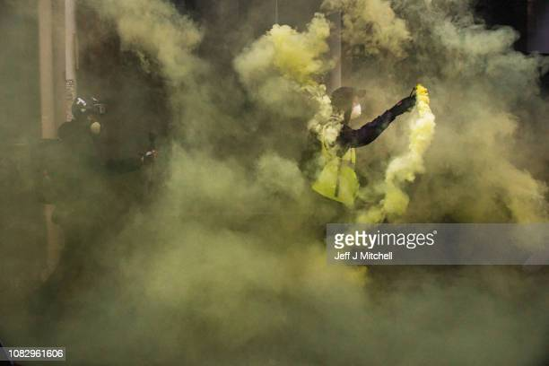 Protesters let off flares near Les Halles during the 'yellow vests' demonstration on December 15, 2018 in Paris, France. The protesters gathered in...