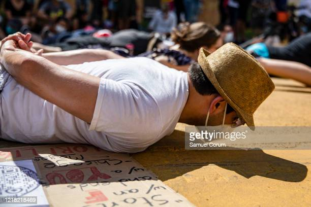 Protesters lie in the middle of the recently renamed Black Lives Matter Plaza near the White House during demonstrations over the death of George...