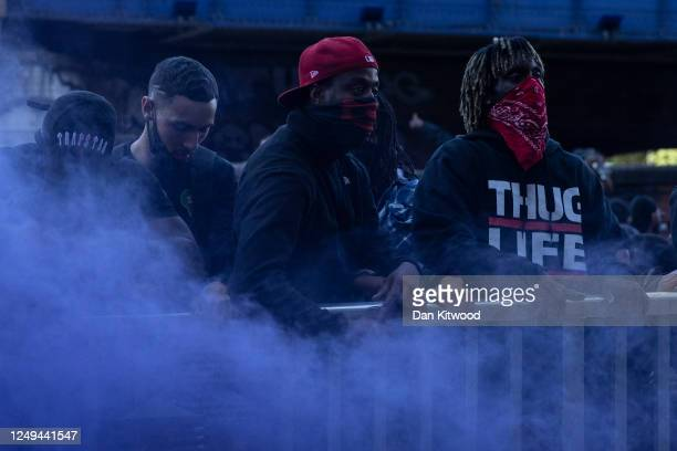 Protesters light a smoke bomb near Waterloo station on June 13 2020 in London United Kingdom Following a social media post by the farright activist...