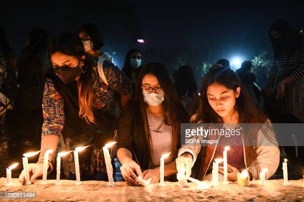 Protesters light candles during the demonstration. Female activists and classmates take part in a candlelight protest demanding justice for the...
