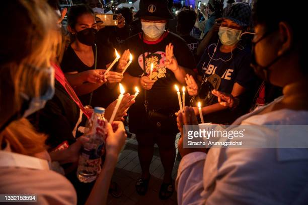 Protesters light candles to pay respect to the dead from the pandemic during the Harry Potter-themed protest at Bangkok Art and Culture Center in...