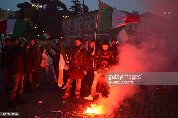 Protesters light flares during a demonstration of the Forconi against austerity policies and the Italian government on December 18, 2013 in Rome. AFP...