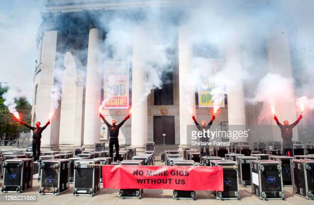 Protesters light smoke flares as 2,000 industry workers from the music and event sectors unite and march socially distanced through Manchester, from...