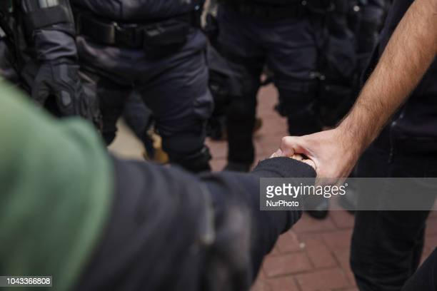 Protesters link hands after a protester was arrested by Ohio State PoliceKaitlin Bennett a former student of Kent State University lead an open carry...