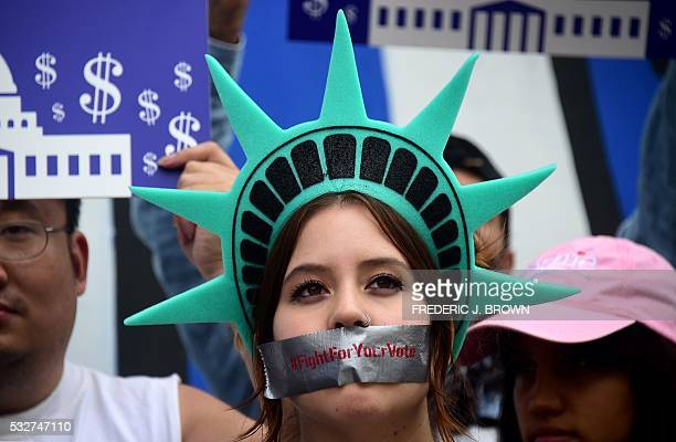 Protesters listen as actress Frances Fisher speak in support of Bernie Sanders backed by his supporters during a downtown rally in Los Angeles,...
