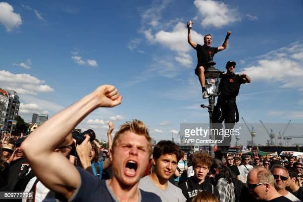 Protesters listen to live music and speeches during the 'Welcome to Hell' rally against the G20 summit in Hamburg northern Germany on July 6 2017...