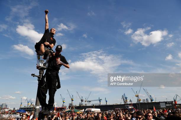 TOPSHOT Protesters listen to live music during the 'Welcome to Hell' rally against the G20 summit in Hamburg northern Germany on July 6 2017 Leaders...