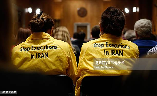 Protesters listen to opening remarks during a markup meeting of the Senate Foreign Relations Committee on the proposed nuclear deal with Iran April...