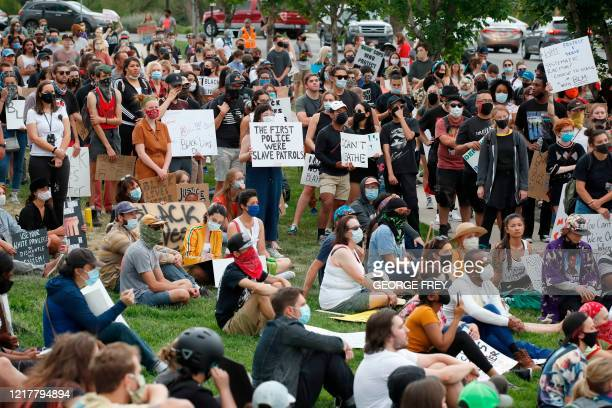 Protesters listen to speakers and chant in front of the Utah State Capitol building during a protest in Salt Lake City, Utah on June 5, 2020. - A...