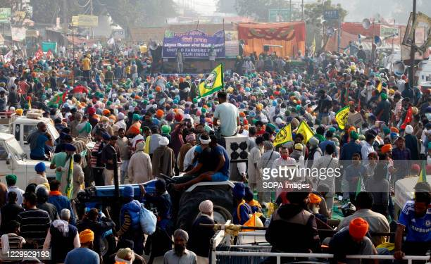 Protesters listening to speeches from the union leaders at Singhu border during the demonstration. As part of the Delhi Chalo march against the...