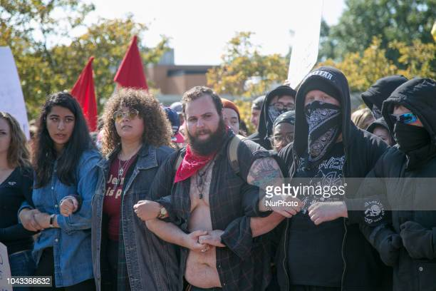 Protesters lock arms during an open carry rally at Kent State University in Kent Ohio on September 29 2018