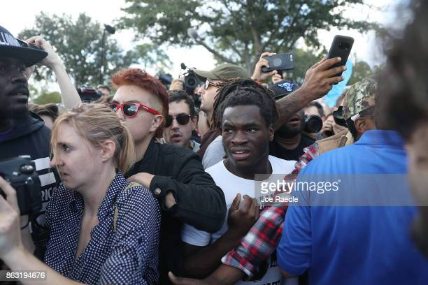 Protesters look on at supporters of white nationalist Richard Spencer who popularized the term ÔaltrightÕ as they leave his speech at the Curtis M...