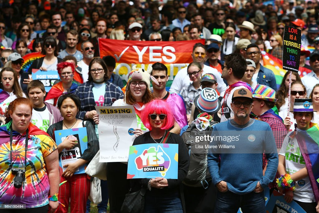 Protesters look on during the YES March for Marriage Equality on October 21, 2017 in Sydney, Australia. Australians are currently taking part in the Marriage Law Postal Survey, which is asking whether the law should be changed to allow same-sex marriage. Results will be announced on November 15.