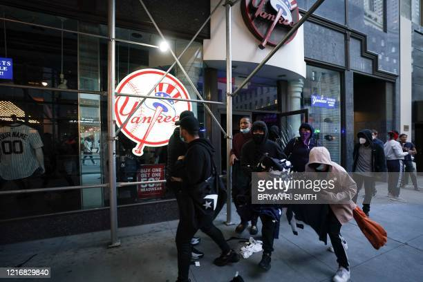 TOPSHOT Protesters loot a NY Yankee store during demonstrations over the death of George Floyd by a Minneapolis police officer on June 1 2020 in New...