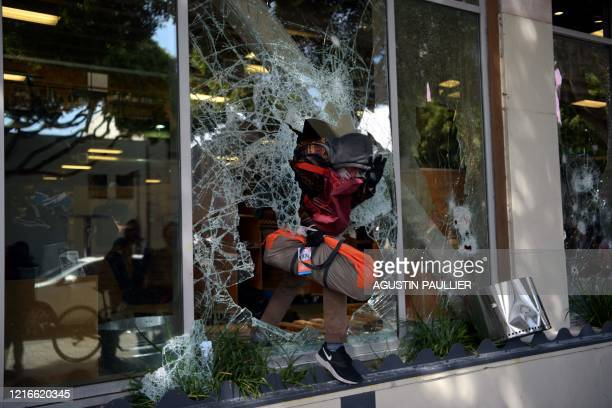TOPSHOT Protesters loot shops during a demonstration over the death of George Floyd at the hands of Minneapolis Police in Santa Monica California on...