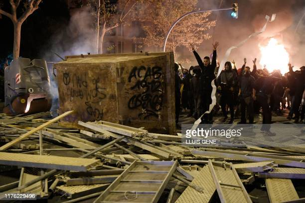 TOPSHOT Protesters make barricades during a demonstration called by the local Republic Defence Committees in Barcelona on October 16 after police...