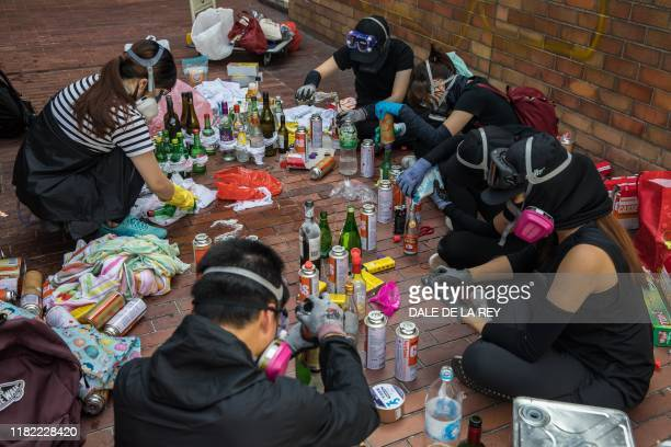 Protesters make molotov cocktails at The Hong Kong Polytechnic University in Hong Kong on November 14 2019 Prodemocracy protesters challenging...