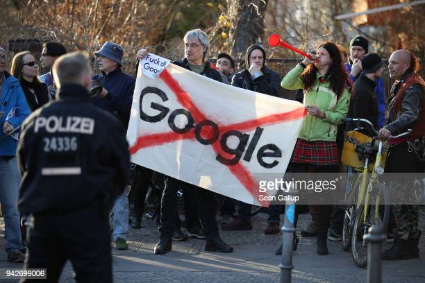 Protesters make noise outside the Umspannwerk building where US tech company Google is to open a Google Campus for startups on April 6 2018 in Berlin...