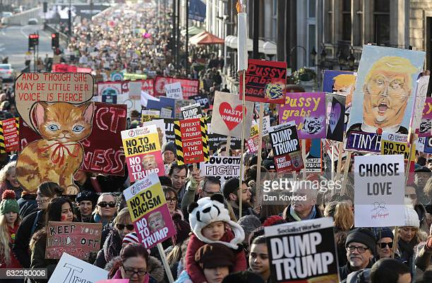 Protesters make their way through the streets of London during the Women's March on January 21 2017 in London England The Women's March originated in...