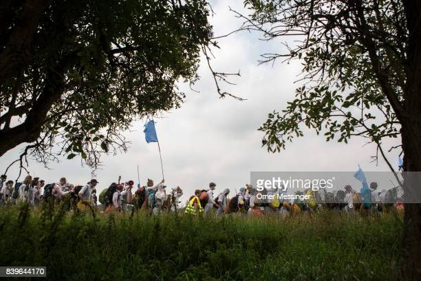 Protesters make their way to the Rhineland mines region west of Cologne on August 26 2017 near Bedburg Germany The group was on its way to block a...