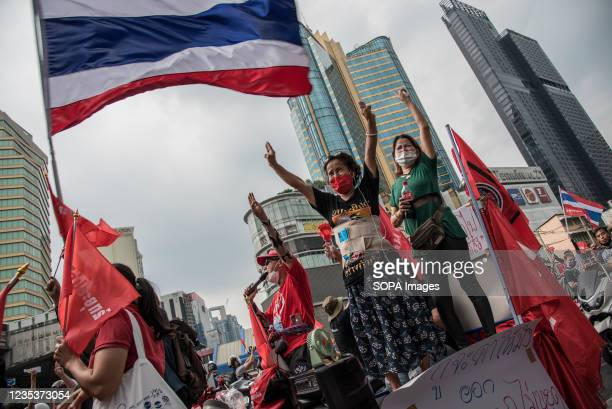 Protesters make three-finger salutes during the car mob rally. Anti-government protesters gathered at Asok intersection before they drove their...