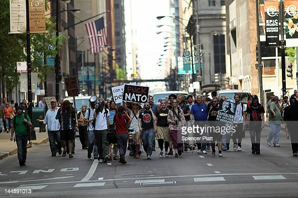 Protesters many affiliated with the Occupy Wall Street movement march down a street on the first day of the NATO summit on May 20 2012 in Chicago...