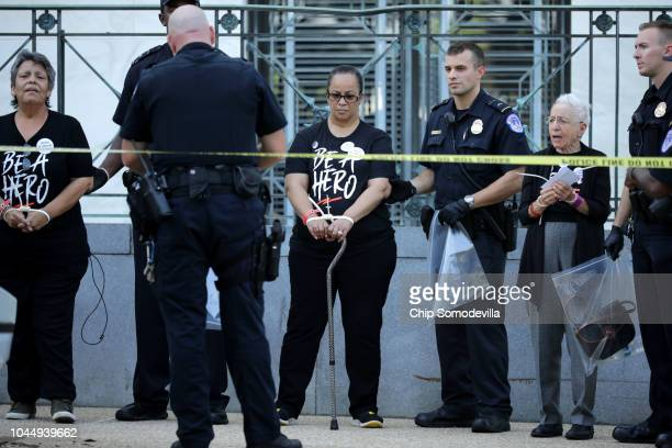 Protesters, many of them sexual assault survivors, are arrested by U.S. Capitol Police for demonstrating against the appointment of Supreme Court...