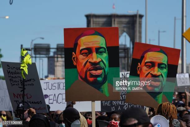 TOPSHOT Protesters march across the Brooklyn Bridge over the death of George Floyd by Minneapolis Police during a Juneteenth rally in New York on...