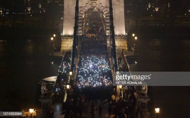Protesters march across the oldest Hungarian bridge the Chain Bridge during their demonstration organised by nonparliamentary parties Momentum...