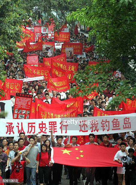 Protesters march against Japan's dealing with its wartime past 10 April 2005 in Guangzhou southern China Around 20000 antiJapanese protesters took to...