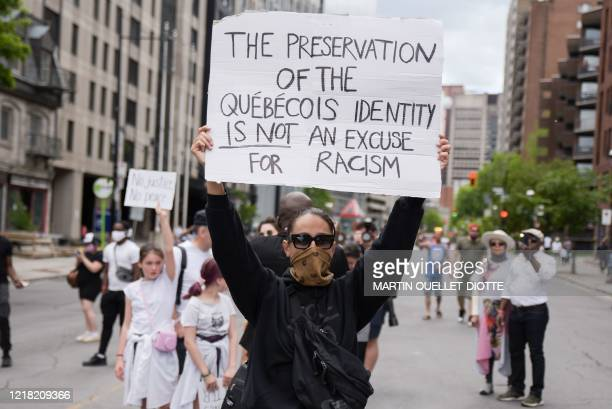 Protesters march against police brutality and racism in Montreal, Canada, on June 7, 2020. - On May 25 Floyd, a 46-year-old black man suspected of...