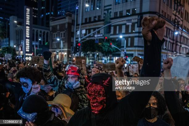 TOPSHOT Protesters march against police brutality in Los Angeles on September 23 following a decision on the Breonna Taylor case in Louisville...
