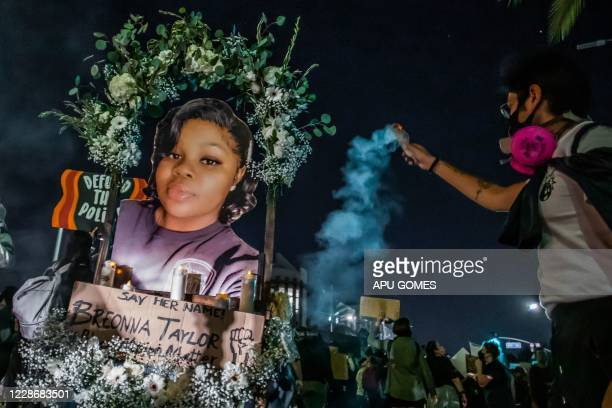 Protesters march against police brutality in Los Angeles, on September 23 following a decision on the Breonna Taylor case in Louisville, Kentucky. -...