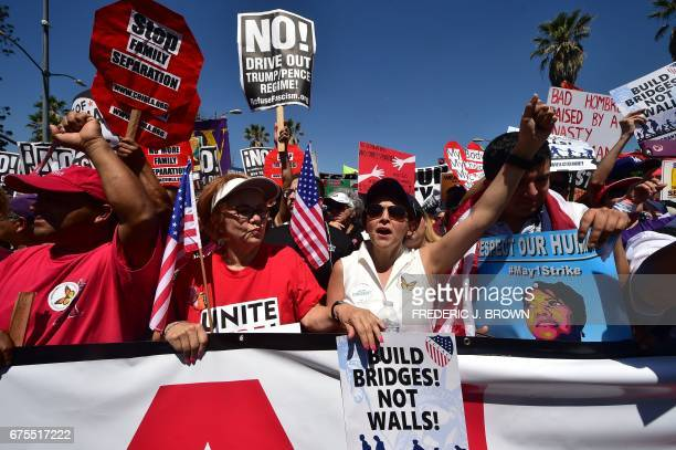 Protesters march against President Donald Trump's immigration policy in Los Angeles California on May 1 where tens of thousands are expected to take...