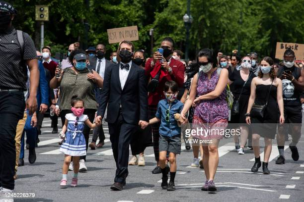 Protesters march against the death of George Floyd and hold the funeral on June 4, 2020 in Harlem, New York. The white police officer, Derek Chauvin,...