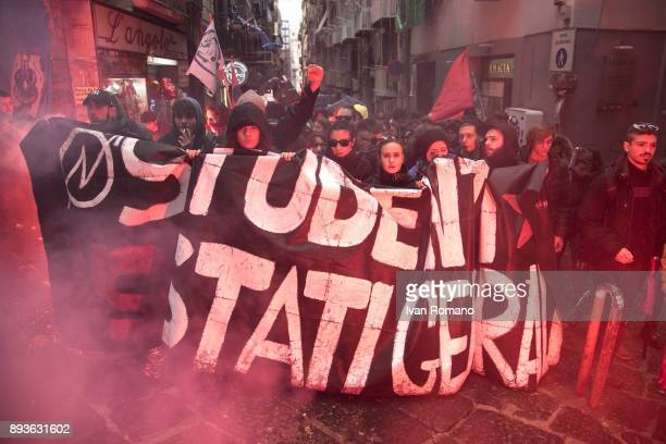 Protesters march against the general states during the ignition of a a flare in the streets of Naples against the schoolwork alternation system...