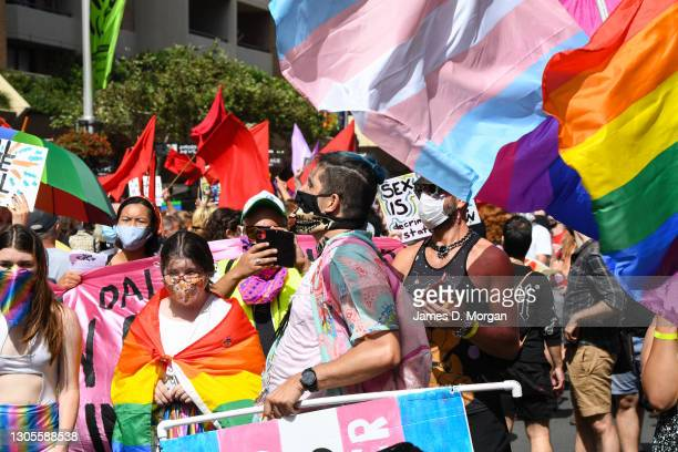 Protesters march ahead of the Sydney Gay and Lesbian Mardi Gras parade as they campaign for LGBTQI rights along Oxford Street on March 06, 2021 in...