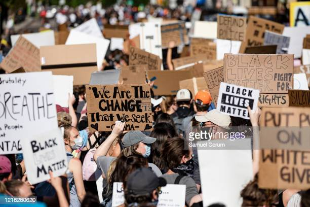 Protesters march along H Street NW near the White House during continued demonstrations over the death of George Floyd while in police custody on...