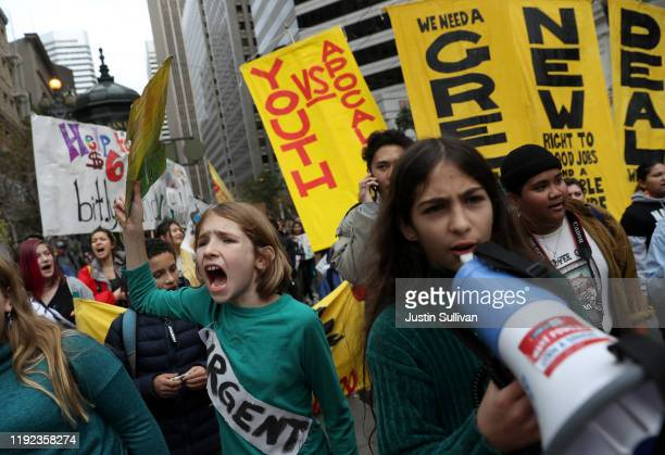 Protesters march along Market Street during a youth climate strike on December 06 2019 in San Francisco California Hundreds of youth climate...