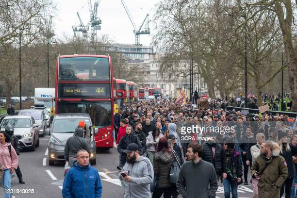 Protesters march along the Park Lane disrupting traffic during the demonstration. Activists and people held a demonstration against the current...