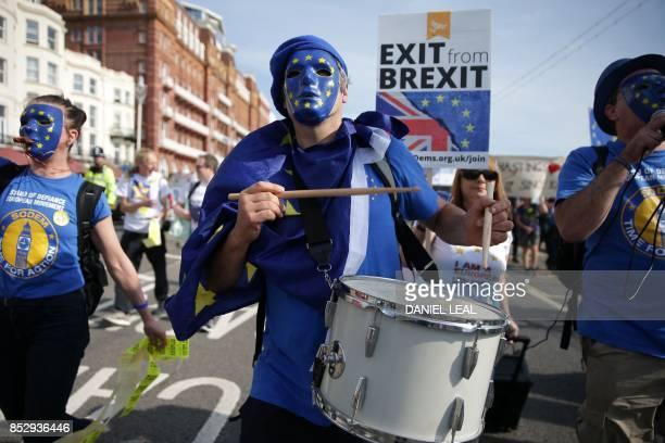Protesters march along the seafront wearing European flag masks in Brighton on September 24 on a march against Brexit Britain's revitalised Labour...
