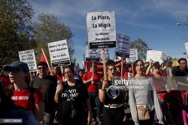 Protesters march along the United StatesMexico border during a rally to show solidarity with the migrant caravan on November 25 2018 US officials...