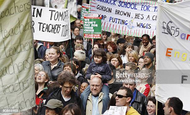 Protesters march along Whitehall during the teachers and general workers protest in central London on April 24 2008 Thousands of British schools face...