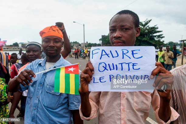 Protesters march and chant slogans during an antigovernment protest led by a coalition of opposition parties in Lome on September 7 2017 Huge crowds...