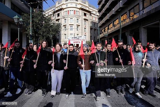 Protesters march and shout slogans as thousands of people take part in a demonstration on December 8 2016 in Athens Greece A nationwide 24hour...