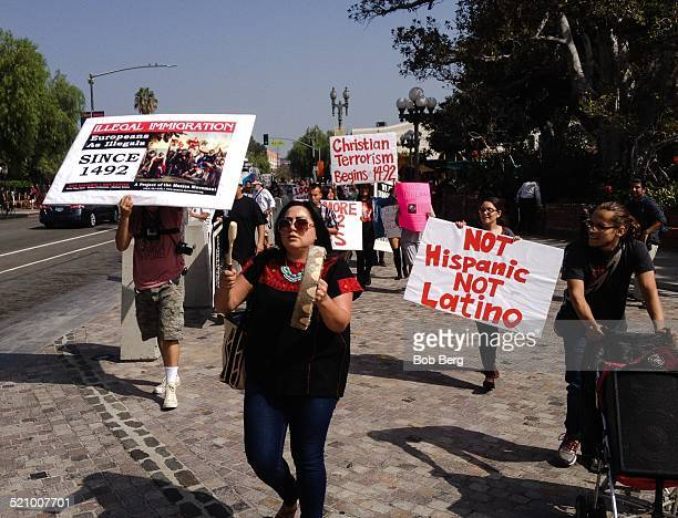 Protesters march at the Protest and March Against Columbus Sunday October 12 2014 in Los Angeles