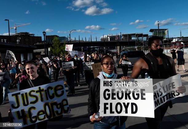 Protesters march by US Bank Stadium in response to the police killing of George Floyd on May 29 2020 in Minneapolis Minnesota Demonstrations and...