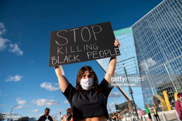 Protesters march by U.S. Bank Stadium in response to the police killing of George Floyd on May 29, 2020 in Minneapolis, Minnesota. Demonstrations and...