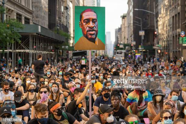 Protesters march down 5th avenue in solidarity for police reform on June 10 in New York City. Protests continue on the sixteenth day across the...